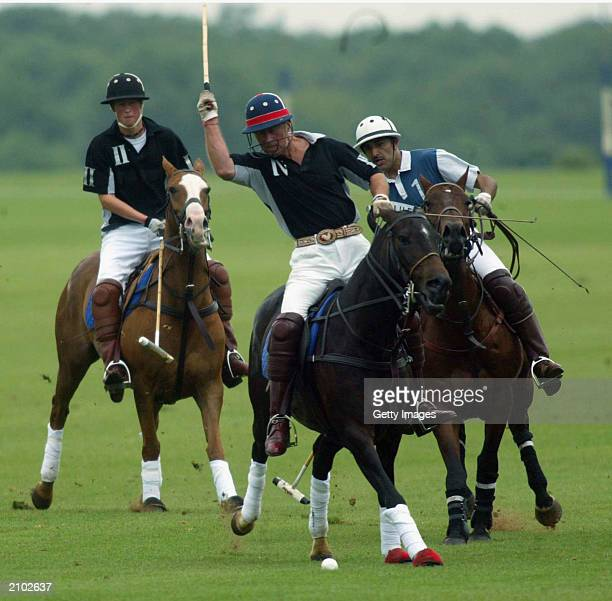 British Prince Charles and Prince Harry plays polo in the Calcot Manor Hotel cup on June 22 2003 at Tetbury Gloucestershire The day after Prince...