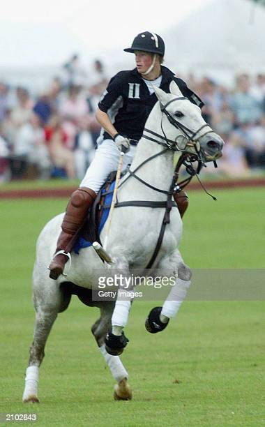 British Prince Harry plays polo in the Calcot Manor Hotel cup on June 22 2003 at Tetbury Gloucestershire The day after Prince Williams 21st birthday...