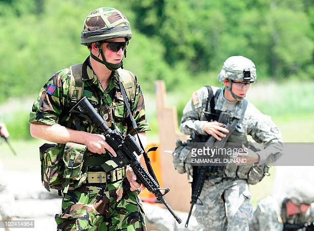 British Prince Harry takes part in an exercise with US military cadets on a firing range at the United States Military Academy in West Point New York...