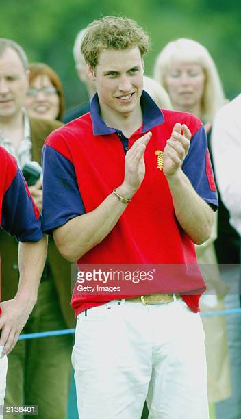 British Prince William applauds after the Highgrove polo charity match against Altu in aid of the Bristol Cancer Help Centre on July 5 2003 in...
