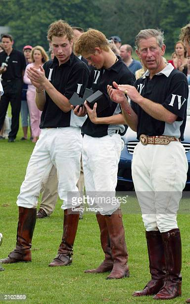 British Prince William brother Prince Harry and their father prince Charles The prince of Wales applaud Harry recieving his prize at the end of the...