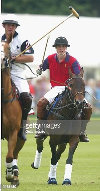 British Prince William playing for Highgrove polo team in a charity match against Altu in aid of the Bristol Cancer Help Centre on July 5 2003 in...