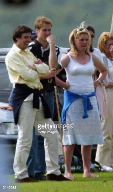 British Prince William watches the match with unidentified girl at Beaufort polo club on July 6 2003 in Tetbury England