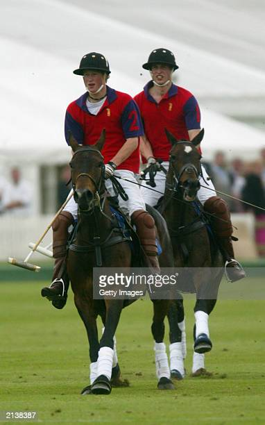 British Princes Harry and William in action during the Highgrove polo charity match against Altu in aid of the Bristol Cancer Help Centre on July 5...