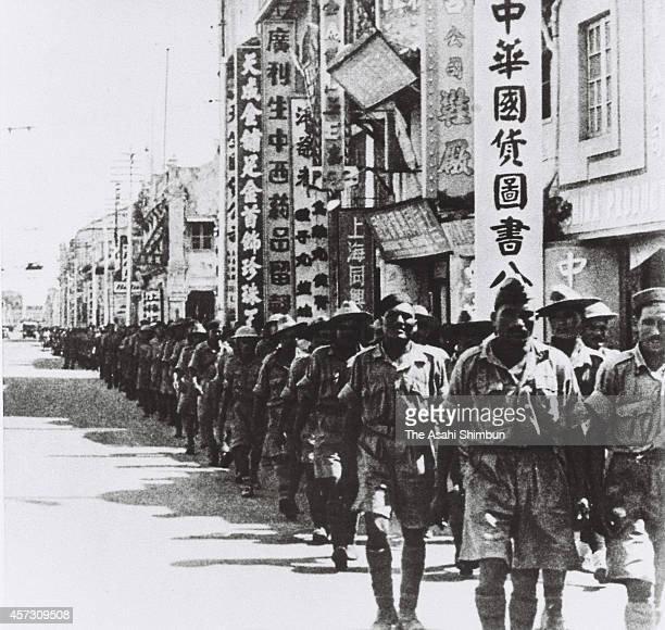 British prisoners of war march on after their surrender in February 1942 in Singapore