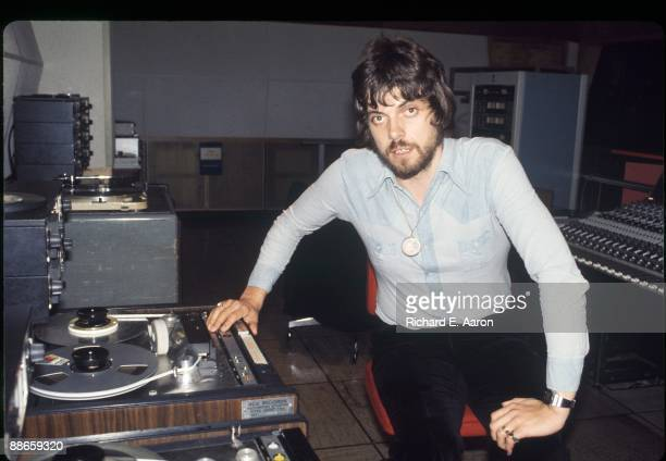 British producer and musician Alan Parsons poses with multitrack tape recorder in the control room of Media Sound Studios recording studio in 1979 in...