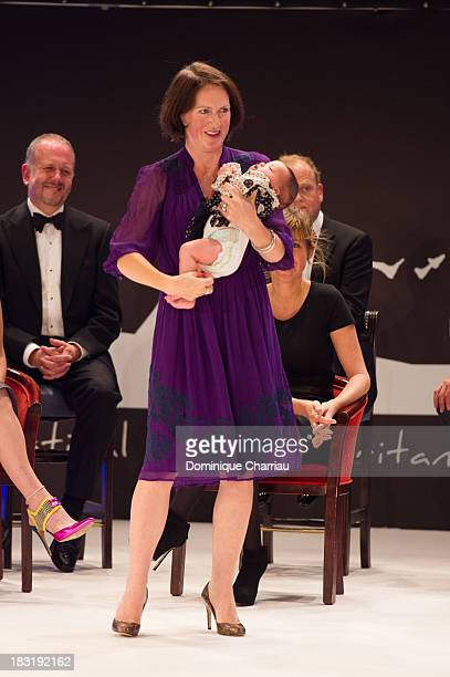British producer Tracy O'Riordan with her baby attends the Dinard British film festival closing ceremony on October 5 2013 in Dinard France