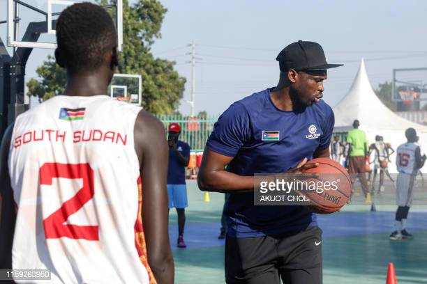 British professional basketball player and National Basketball Association star Luol Deng trains young players at Manute Bol basketball court on...
