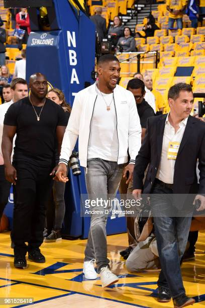 British professional boxer Anthony Joshua attends a game between the Houston Rockets and Golden State Warriors in Game Four of the Western Conference...