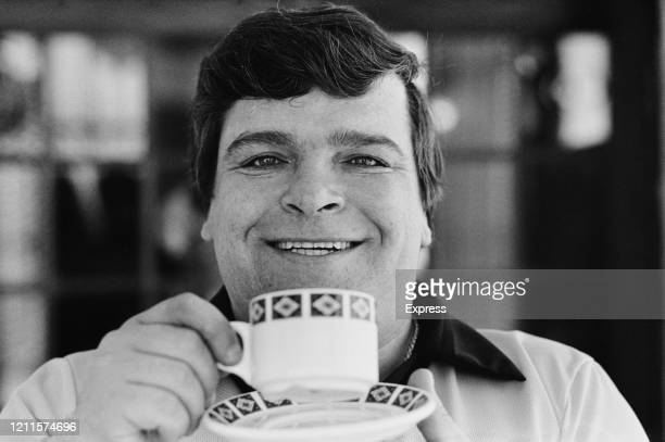 British professional darts player Jocky Wilson holding a tea cup and saucer during the BDO World Darts Championship, held at Jollees in...