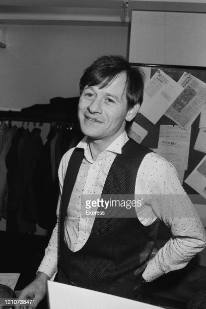 British professional snooker player Alex Higgins wearing a shirt with a dot pattern beneath a waistcoat, backstage during the 1985 Masters Snooker at...