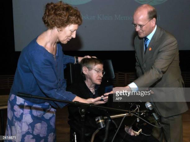 British Professor Stephen Hawking of Cambridge University England sitting receives the Oskar Klein Medal from Swedish Minister of Education Thomas...