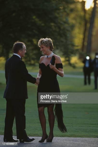 British property developer Peter Palumbo and British royal Diana Princess of Wales wearing a black Christina Stambolian dress attend a Vanity Fair...