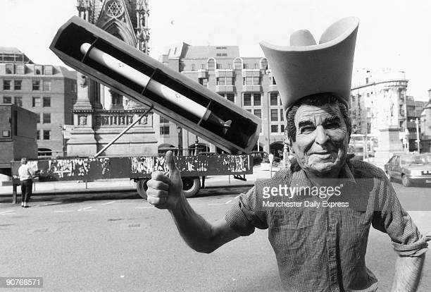 British protester wearing a Reagan mask in front of a Cruise missile Reagan president of the United States was responsible for the greatest peacetime...