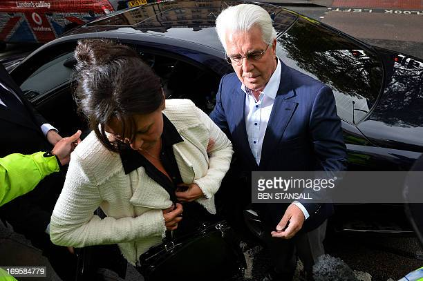 British publicist Max Clifford accompanied by his wife Jo Westwood arrives at Westminster Magistrates Court in central London on May 28 2013 where he...