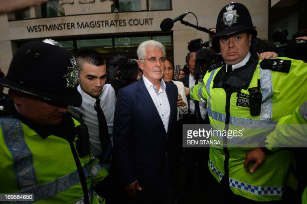 British publicist Max Clifford leaves Westminster Magistrates Court in central London on May 28 2013 where he entered not guilty pleas after being...
