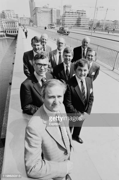 British publisher Philip Kogan founder of Kogan Page on London Bridge with fellow businessmen London UK 16th June 1984