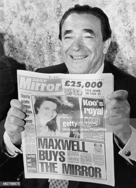 British publisher Robert Maxwell holding a copy of the Daily Mirror newspaper at a press conference to announce his acquisition of Mirror Group...