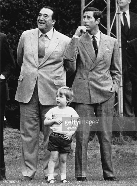 British publisher Robert Maxwell with Prince Charles and his son Prince William in the gardens of Kensington Palace London 23rd May 1985 They are...
