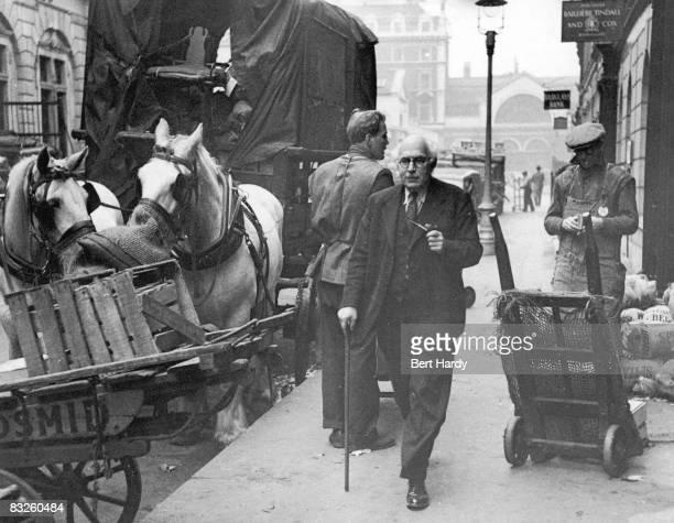 British publisher Victor Gollancz strolls through Covent Garden Market London on his way to his office in Henrietta Street 18th March 1950 Original...