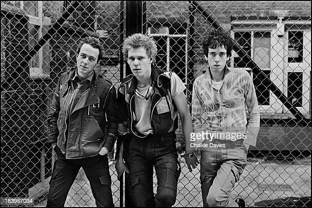 British punk group The Clash in north London, April 1977. Left to right: singer Joe Strummer , bassist Paul Simonon and guitarist Mick Jones.