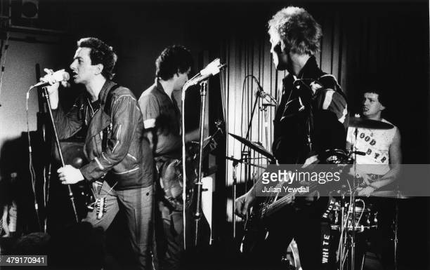 British punk group The Clash performing at the Coliseum, Harlesden, London, 11th March 1977. Left to right: Joe Strummer , Mick Jones, Paul Simonon...