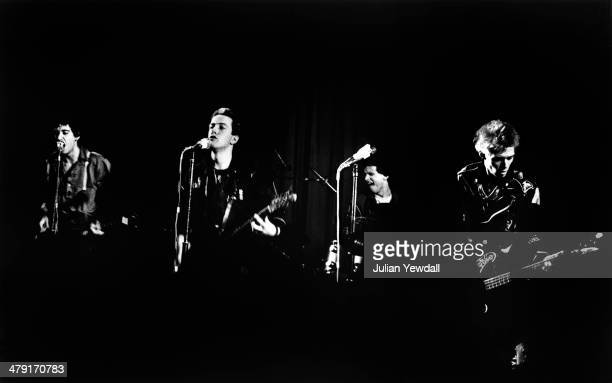 British punk group The Clash performing their second show of the year at the Coliseum cinema, Harlesden, London, 11th March 1977. Left to right: Mick...