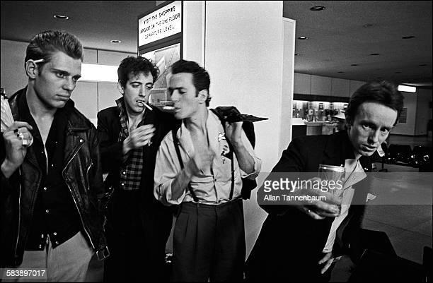 British punk rock group the Clash from left Paul Simenon Mick Jones Joe Strummer and Topper Headon arrive at JFK airport New York New York July 26...