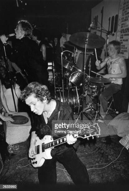 British punk rock group The Sex Pistols performing live at the 100 Club London From left to right Johnny Rotten Steve Jones and Paul Cook Original...