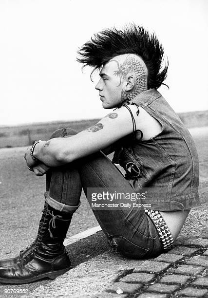 British punk with tattoos Mohican hairstyle and piercings