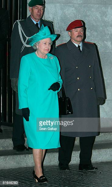 British Queen Elizabeth II accompanied by German military officers arrives at the Neue Wache war memorial where she laid a wreath on the first day of...