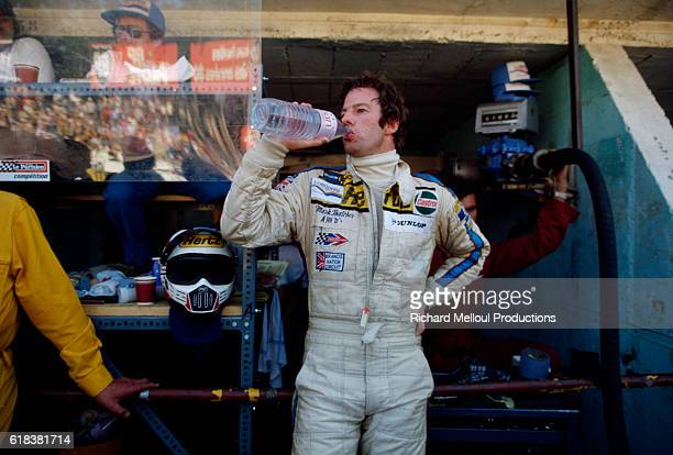British racecar driver Mark Thatcher takes a drink of water while competing in the 1982 Le Mans 24 Hours Thatcher is the son of British prime...