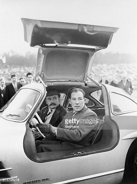 British racecar driver Stirling Moss test drives a MercedesBenz 300 SL sports coupe during a race meeting at Brands Hatch Circuit in Kent England...
