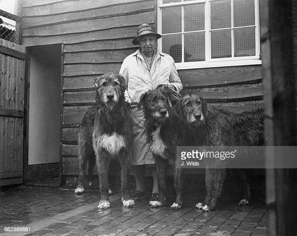 British racehorse breeder and trainer and dog breeder Florence Nagle with three of her Irish wolfhounds at her home Westerlands stud farm in Petworth...