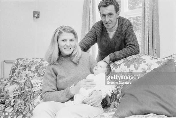 British racehorse trainer and former jockey Josh Gifford posed with his wife Althea and their newborn daughter Kristina at home on 7th November 1970...