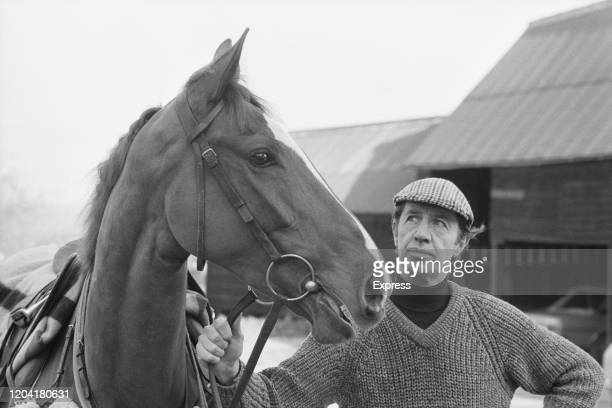 British racehorse trainer Tim Forster poses with horse Drum Downey at his Old Manor House stables in Letcombe Bassett Berkshire 12th March 1985