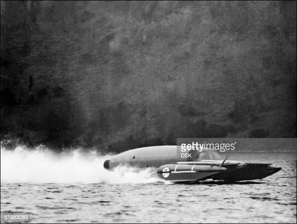 British racer and son of Sir Malcolm Campbell, Donald Campbell, driving Blue Bird reaches 250 km per hour on the lake of Ullswater, England, 16 March...