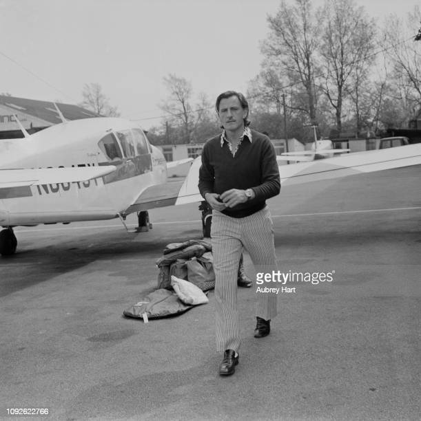British racing driver and team owner Graham Hill at an airport, UK, 29th April 1975.