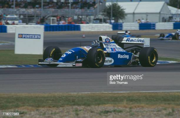 British racing driver Damon Hill drives the Rothmans Williams Renault Williams FW16 Renault RS6 35 V10 to finish in first place to win the 1994...