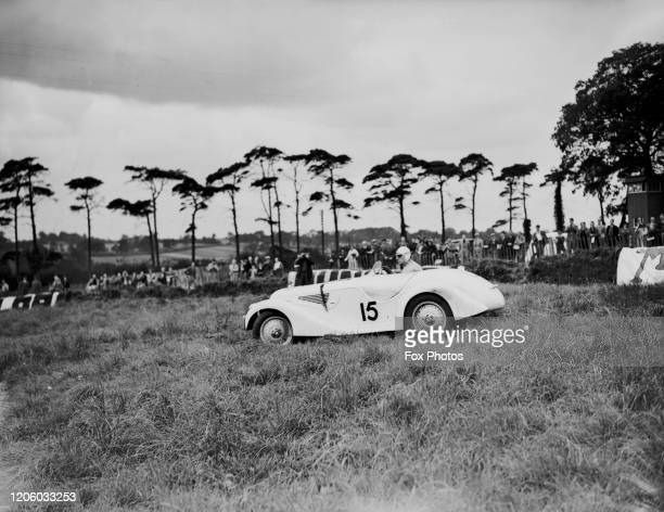 British racing driver Dick Seaman on his BMW 328 Frazer Nash race car driving off the tracks at Melbourn Corner where he turned completely round on...