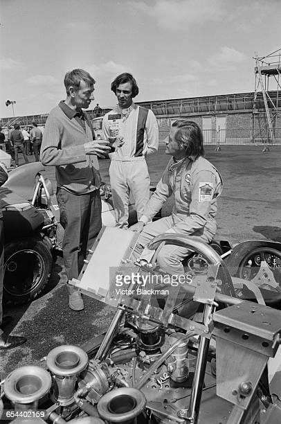 British racing driver Graham Hill and Australian driver Tim Schenken discuss tactics at Silverstone with Ron Tauranac manager of the Brabham team UK...