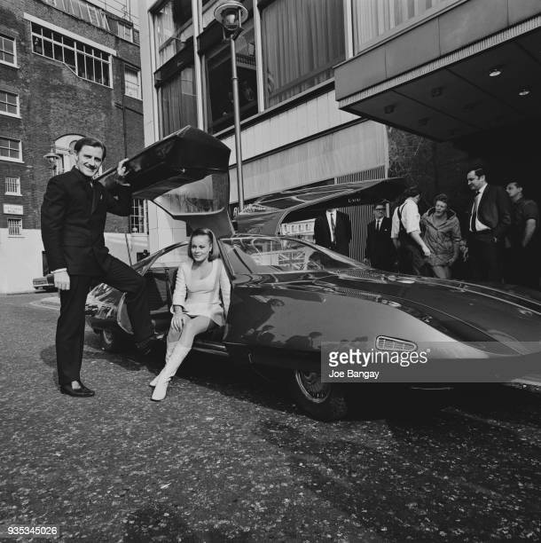 British racing driver Graham Hill and Austrian actress Loni Von Friedl with futuristic car 'Doppelganger' built by Alan Mann Racing, which was...