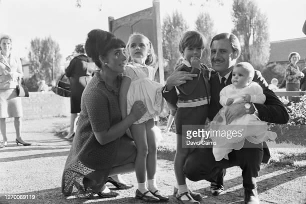 British racing driver Graham Hill and his wife Bette at the christening of their daughter Samantha, UK, 19th September 1965. They are pictured with...