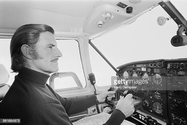 British racing driver Graham Hill at the controls of his Piper PA-23-350 Aztec light aircraft at Elstree Airfield, Hertfordshire, 5th April 1971. On...