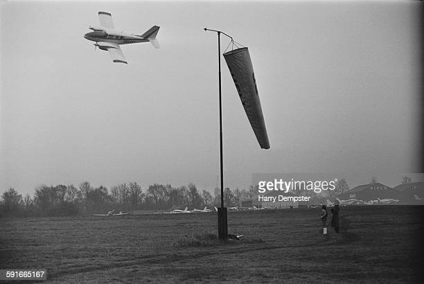 British racing driver Graham Hill takes off from Elstree Airfield Hertfordshire in his Piper PA23350 Aztec light aircraft 5th April 1971 He is waved...
