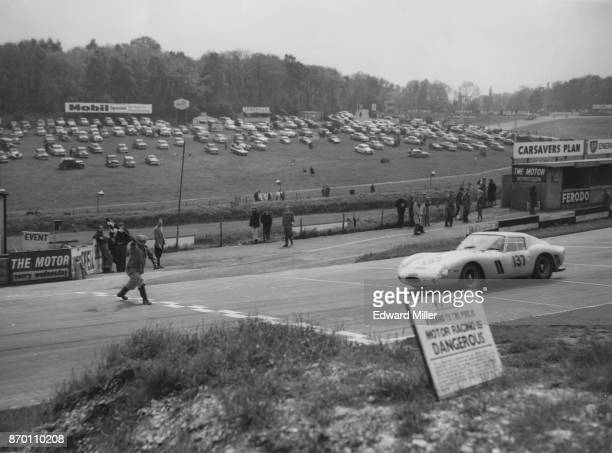 British racing driver Innes Ireland wins the Peco Trophy at Brands Hatch in his Ferrari 250 UK 27th May 1962