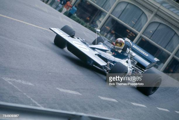 British racing driver Jackie Stewart drives the Elf Team Tyrrell Tyrrell 003 Ford Cosworth DFV to finish in first place to win the 1971 Monaco Grand...