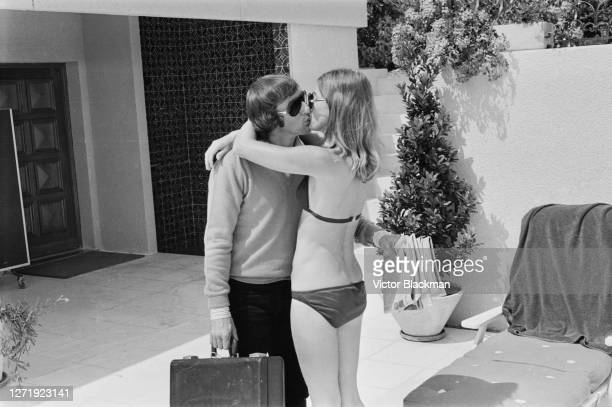 British racing driver Jackie Stewart kissing his wife Helen at their home UK 23rd July 1972 From the Daily Express photo serial 'My Life With Jackie'