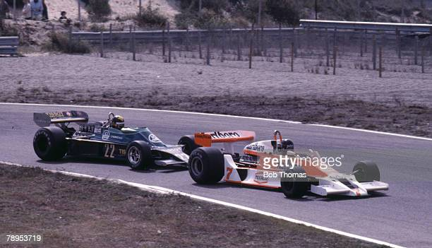 British racing driver James Hunt driving the Marlboro Team McLaren McLaren M26 Ford V8 leads Irish racing driver Derek Daly in the Team Tissot Ensign...