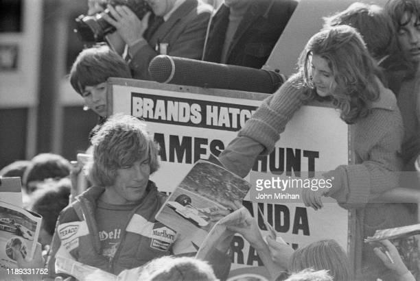 British racing driver James Hunt signing autographs to fans at Brands Hatch, UK, 7th November 1976.